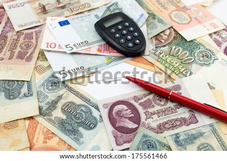 The photo of old Russian ruble banknotes, several euro and code generator. - stock photo