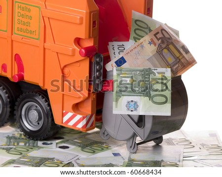 The photo shows some banknotes, a garbage container and a garbage truck - stock photo