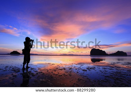 The Photographer  Photographer takes a good shot on the PangMeng beach,Trang, Thailand - stock photo