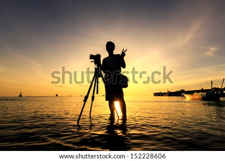 The Photographer takes a good shot on the Huahin beach, Thailand