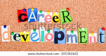 The phrase career development in cut out magazine letters pinned to a cork notice board - stock photo