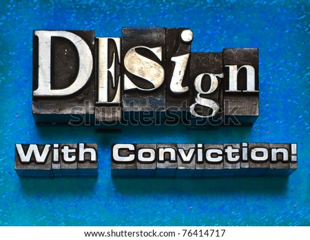 "The phrase ""Design With Conviction"" done in old letterpress type. - stock photo"