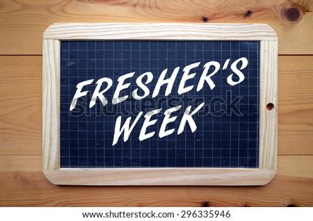 The phrase Fresher's Week in white text on a slate blackboard - stock photo