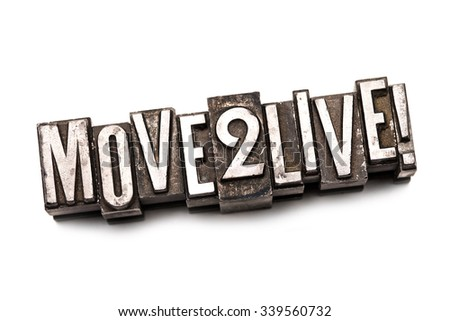 "The phrase ""Move 2 Live!"" in letterpress type. Cross processed, narrow focus."
