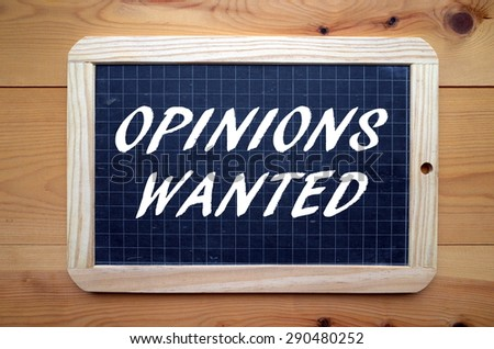 The phrase Opinions Waned in white text on a slate blackboard - stock photo