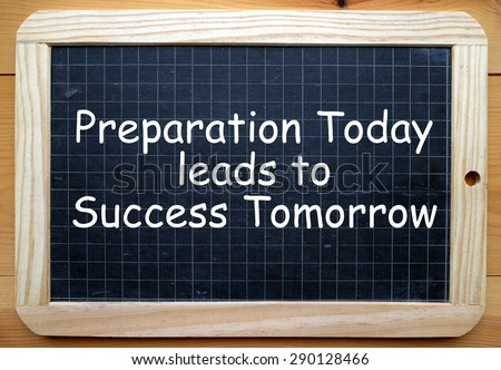 The phrase Preparation Today leads to Success Tomorrow in white text on a slate blackboard - stock photo