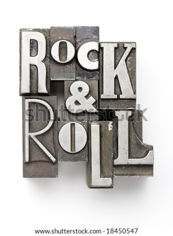 The phrase Rock & Roll photographed using a mix of vintage letterpress characters. - stock photo