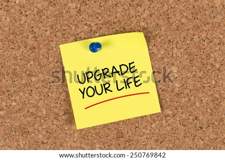 The phrase Upgrade Your Life written on Sticky Note - stock photo