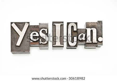 "The Phrase ""Yes I can!"" in letterpress type over white. Slight cross process effect. - stock photo"