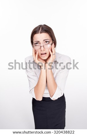 The picture of a beautiful upset business woman with glasses on white background
