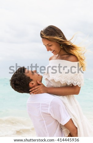 The picture of happy couple in love on the beach - stock photo