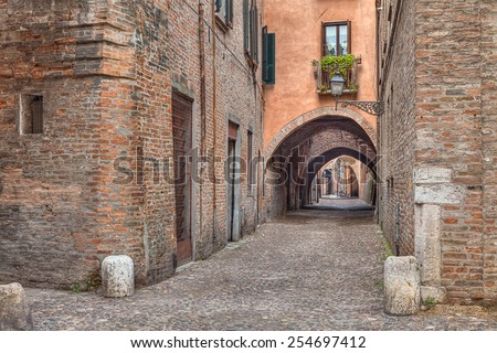 the picturesque alley Via delle Volte, ancient medieval street in Ferrara, Emilia Romagna, Italy 