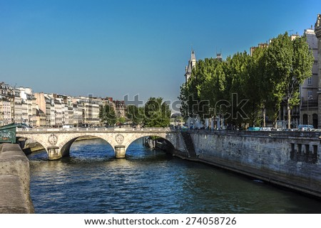 The picturesque embankments of the Seine River and bridge. Paris, France. - stock photo