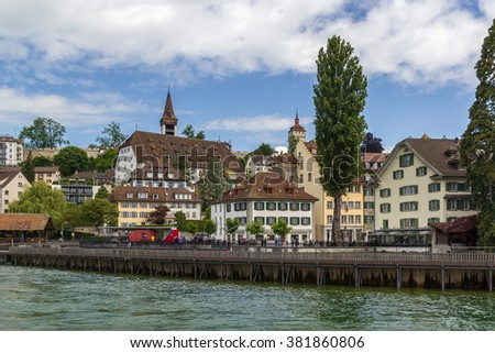 The picturesque historical buildings on the embankment of Reuss river in Lucerne, Switzerland - stock photo