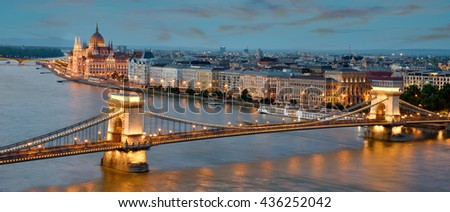 The picturesque landscape of the Parliament and the bridge over the Danube in Budapest, Hungary - stock photo