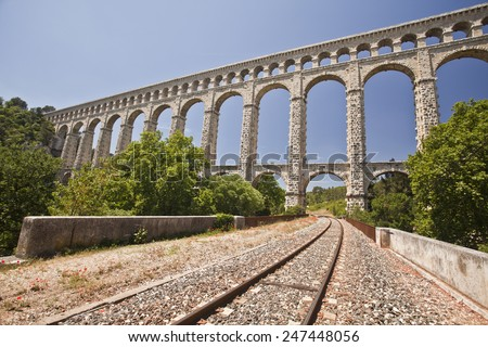 The picturesque nature of southern France with its famous landmark roman bridge , located near Avignon, France - stock photo