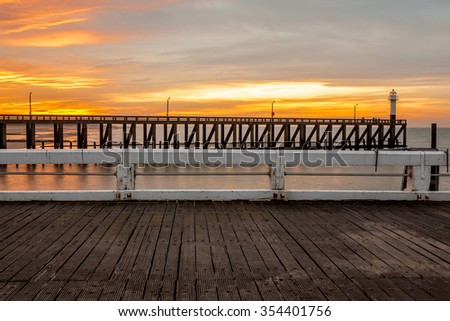 The pier that reaches deep into the sea - stock photo