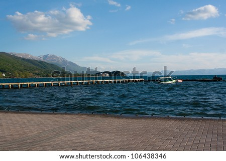 The pier with a boat in lake Ohrid, Macedonia - stock photo