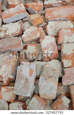 the piled old bricks of red color - stock photo
