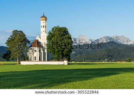 The pilgrimage church Sankt Coloman with mountain setting.
