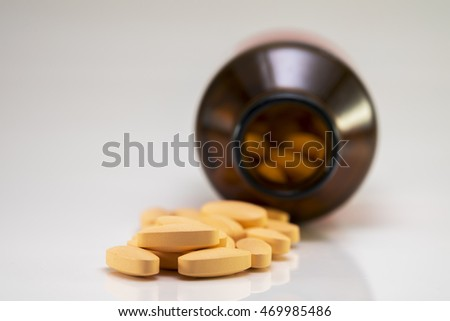 The pill and bottle on white background.