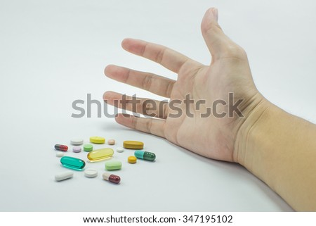 The pill package in hand on the white background