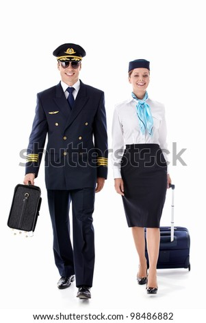 The pilot and stewardess on a white background - stock photo