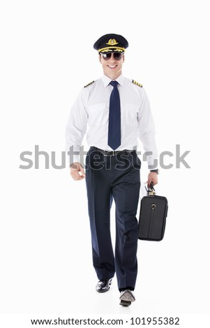 The pilot in sunglasses with a suitcase on a white background - stock photo