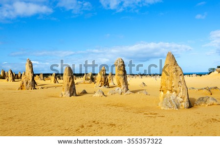 The Pinnacles are limestone formations within Nambung National Park, near the town of Cervantes, Western Australia. - stock photo