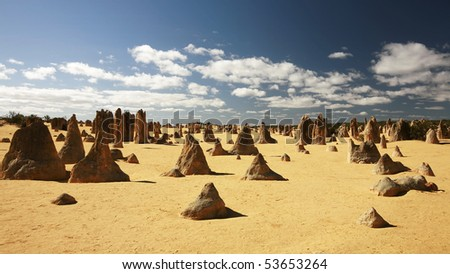 The Pinnacles are limestones uncovered from soft sand being blown away by strong wind in Western Australia. - stock photo