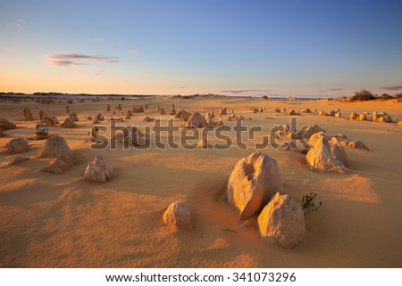The Pinnacles Desert in the Nambung National Park, Western Australia. In the light of a setting sun. - stock photo