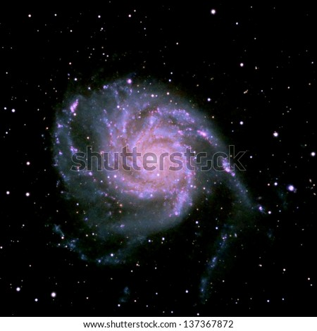 The Pinwheel galaxy, a face on spiral galaxy about twenty-one million light years away in the constellation Ursa Major - stock photo