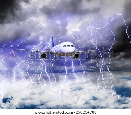 The plane flies through a storm with lots of lightning in a storm. - stock photo