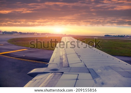 The plane landed at the airport - stock photo