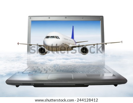 The plane takes off from the laptop screen, soaring in the clouds - stock photo