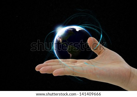 The planet earth hovering in a hand