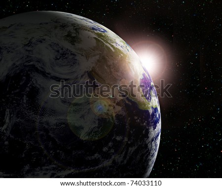 The planet Earth in sun beams - stock photo