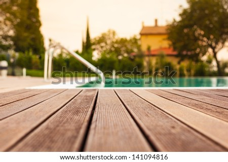 the planking of a swimming pool with shallow depth of field - stock photo
