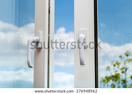 The plastic window is and a pen on a beautiful blurred background