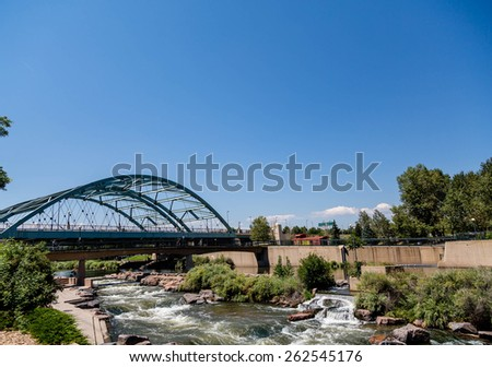 The Platte river running under a bridge in Confluence Park in Denver, Colorado - stock photo