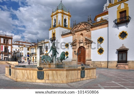 The plaza del Socorro is one of the more popular plazas in Ronda with numerous cafes and restaurants on its perifery, as well a beautiful parish church on one side. - stock photo