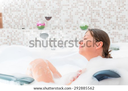The pleasure of relaxation in the bath with foam - stock photo