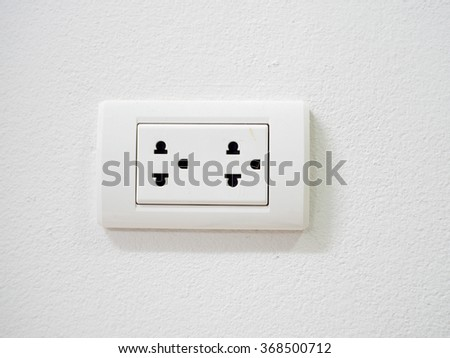 The plug on the wall - stock photo