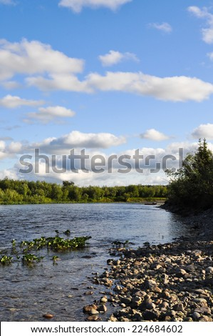 The polar Urals. Pebble river banks. River Northern landscape, clean water and environmental grace. - stock photo