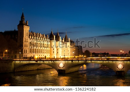 The Pont au Change, bridge over river Seine and the Conciergerie, a former royal palace and prison in Paris, France - stock photo