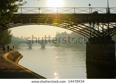 The Pont des Arts in warm morning light, Paris - stock photo