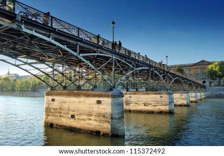 The Pont des Arts or Passerelle des Arts bridge across river Seine in Paris, France. - stock photo