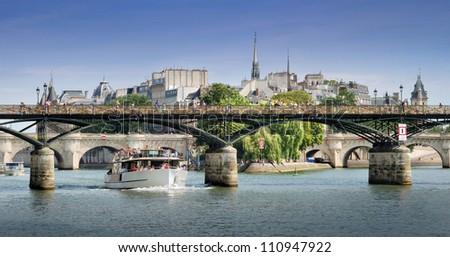The Pont des Arts or Passerelle des Arts, bridge across Seine river in Paris, France. - stock photo