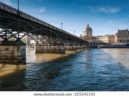 The Pont des Arts or Passerelle des Arts is a pedestrian bridge in Paris - stock photo