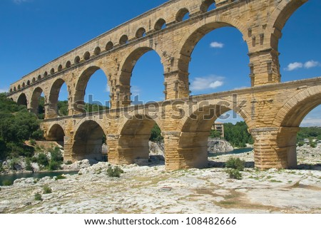 The Pont du Gard is an ancient Roman aqueduct bridge that crosses the Gardon River in southern France